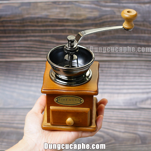 Trên tay là cối xay tay cà phê TM8521A